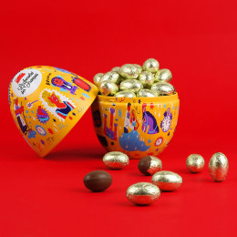 Boîte jaune garnie d'œufs au chocolat au lait praliné 250g
